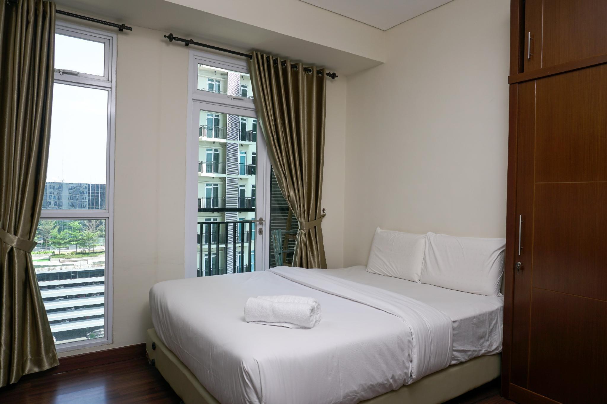 Homey Studio Puri Orchard Apartment By Travelio