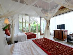 Putri Ayu Cottages Bali - Kamar Tidur
