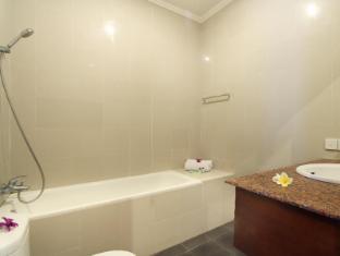 Putri Ayu Cottages Bali - Badezimmer
