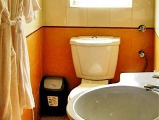 Aldeia Santa Rita Hotel North Goa - बाथरूम
