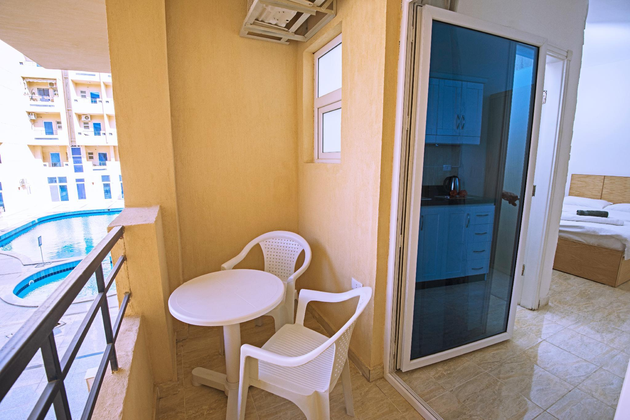 Cozy Pool View Studio With Balcony and Kitchenette